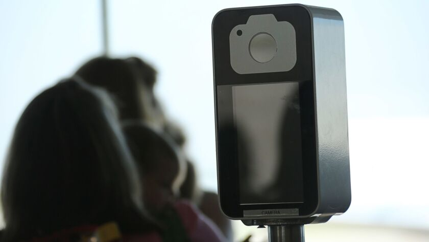 A camera in a facial recognition screening device at Orlando International Airport in Florida.