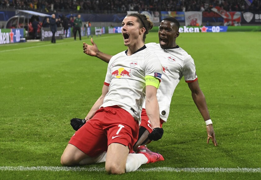 Leipzig's Marcel Sabitzer, center, celebrates after scoring a goal during the Champions League round of 16, 2nd leg soccer match between RB Leipzig and Tottenham Hotspur in Leipzig, Germany, Tuesday, March 10, 2020. (Hendrik Schmidt/dpa via AP)