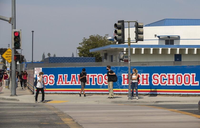 Students on sidewalk outside Los Alamitos High School