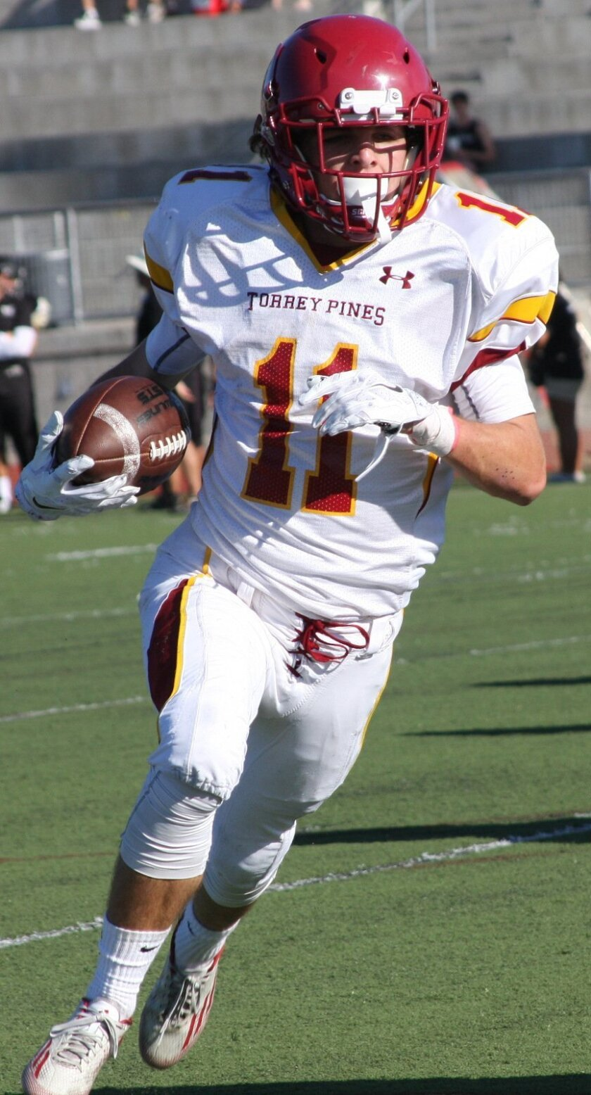 Quarterback Chris Temby passed for 100 yards. Photo by Anna Scipione