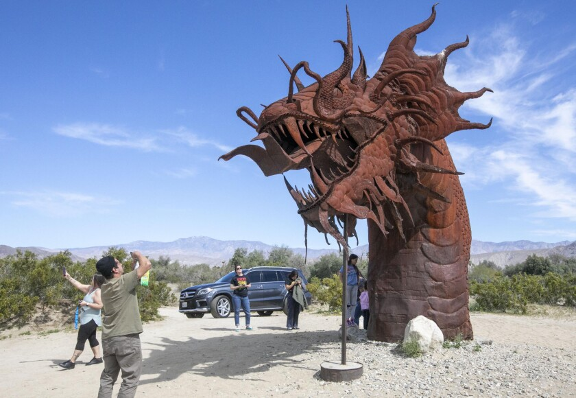 Although Anza-Borrego Desert State Park is closed, the works of artist Ricardo Breceda are on private property and not closed. Two Vista families escaped their homes to get some fresh air in Borrego Springs, CA, on Wednesday, April 1, 2020 during the Coronavirus pandemic.