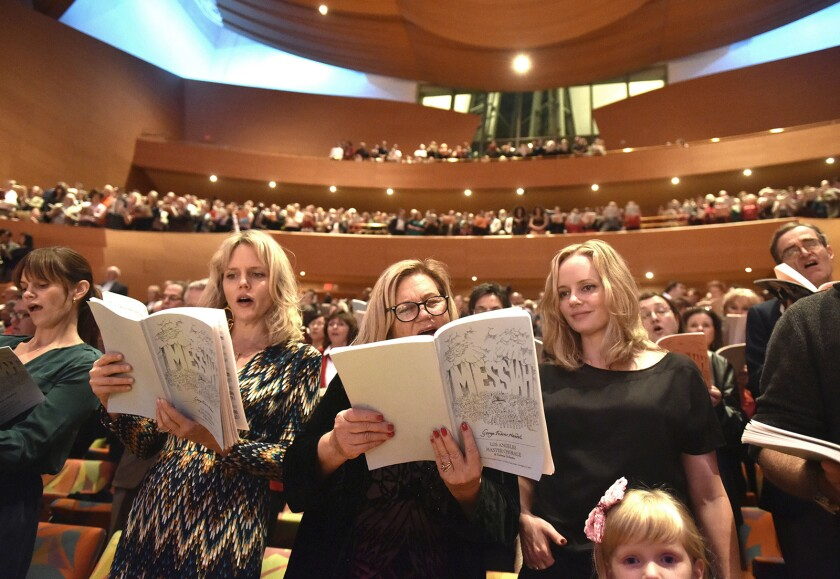 Patrons join the chorus during the 34th Annual Messiah Sing-Along at Walt Disney Concert Hall Sunday