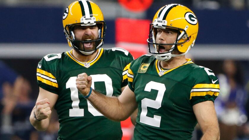 Packers kicker Mason Crosby (2) celebrates his 56-yard field goal against the Cowboys with holder Jacob Schum (10) during the fourth quarter Sunday.