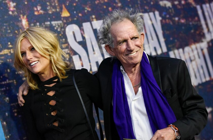 Keith Richards and wife Patti Hansen attend the SNL 40th Anniversary Special at Rockefeller Plaza on Sunday, Feb. 15, 2015, in New York. (Photo by Evan Agostini/Invision/AP)