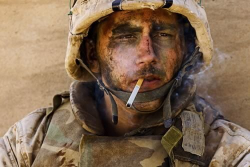 "This is the photo that made Marine Lance Cpl. James Blake Miller -- the ""Marlboro Marine"" --famous. This photo also changed my life. I'm Luis Sinco, a Los Angeles Times staff photographer, and I took it while embedded with his Marine unit in Fallouja. We had spent the previous night in a traffic circle, pinned down by enemy fire, and just before I snapped this photo, a tank had blasted an insurgent position next door to ours. Many people looked at the photo and saw a heroic figure; I saw, in his eyes, a man at the point of breaking. It was how I felt, too."