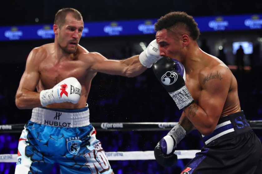 Sergey Kovalev lands a left to the head of Andre Ward during their light-heavyweight title bout in November of 2016.