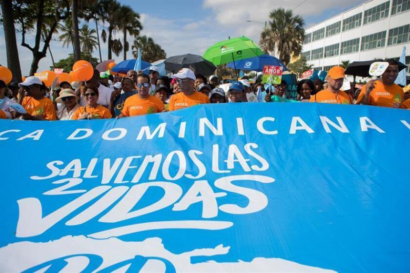People participate in the 'A Step for My Family' (Un Paso por Mi Familia) march called by the Dominican Catholic Church to express their rejection of the decriminalization of abortion, in Santo Domingo, Dominican Republic, 18 November 2018. EFE-EPA/Orlando Barria
