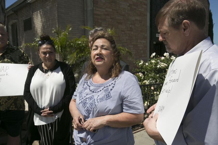 Cousins Judith Louise-Woraschek, left and Cathie Ray, middle, say they were children when they were sexually abused by Msgr. Gregory Sheridan, then the pastor of Saint Jude Shrine of the West. Standing with them is David Clohessy, former national director of Survivors Network of those Abused by Priests (SNAP).
