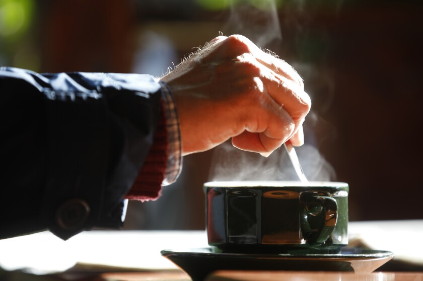 A man stirs a coffee May, 19, 2021 in Strasbourg, eastern France.