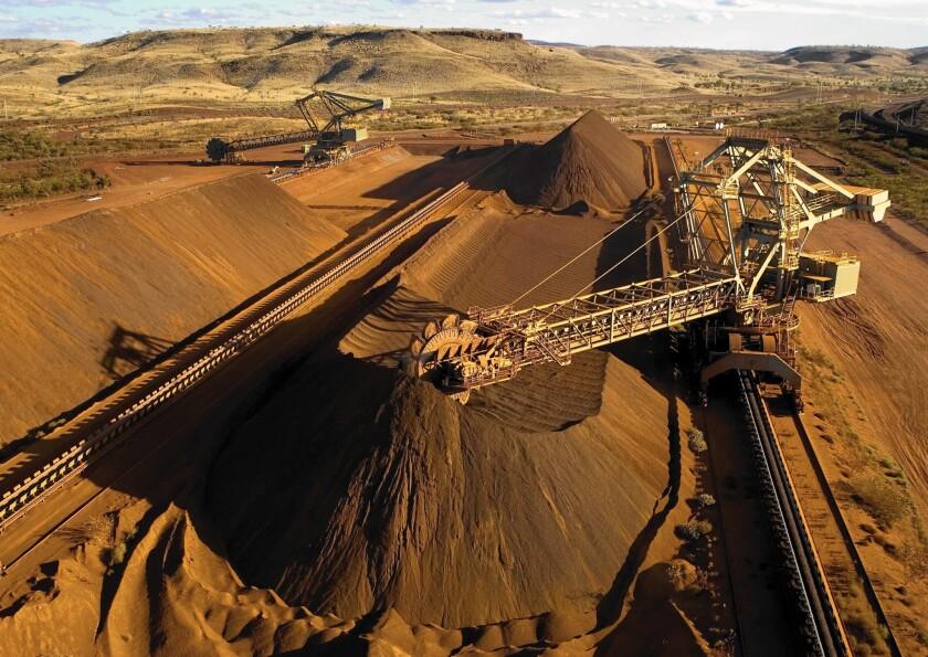 A reclaimer works in the Yandicoogina stockyard and loading a conveyor with high grade iron ore in Western Australia's Pilbara region.