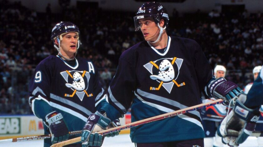 Teemu Selanne, right, with teammate Paul Kariya during the 2000 season.