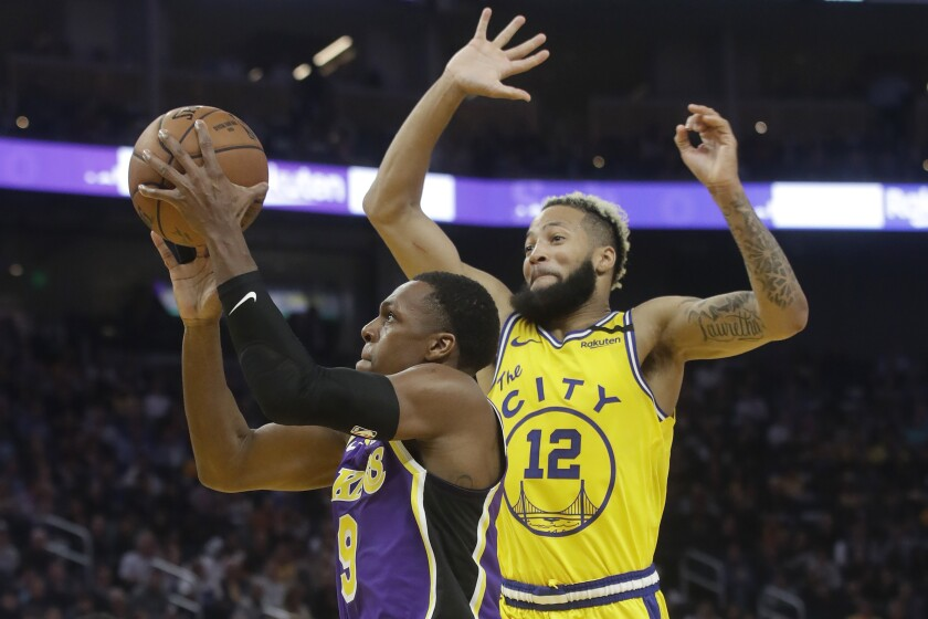 Los Angeles Lakers guard Rajon Rondo (9) shoots against Golden State Warriors guard Ky Bowman (12) during the first half of an NBA basketball game in San Francisco, Thursday, Feb. 27, 2020. (AP Photo/Jeff Chiu)