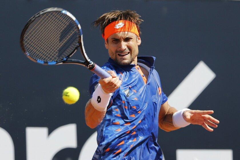 David Ferrer of Spain returns the ball to Albert  Ramos-Vinolas of Spain, at the Rio Open tennis tournament in Rio de Janeiro, Brazil, Thursday, Feb. 18, 2016. (AP Photo/Silvia Izquierdo)