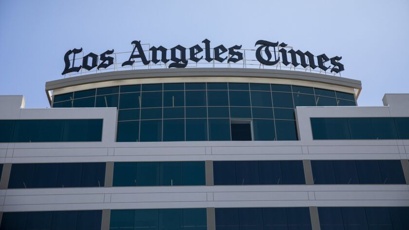 EL SEGUNDO,CA --WEDNESDAY, JUNE 27, 2018--Workers put the new sign on top of the new Los Angeles Tim
