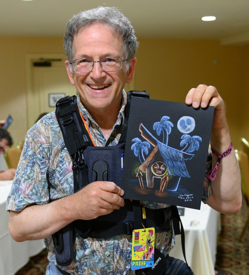 CAPTION 4 - Jan with his Tiki on Black Paper art creation.jpg