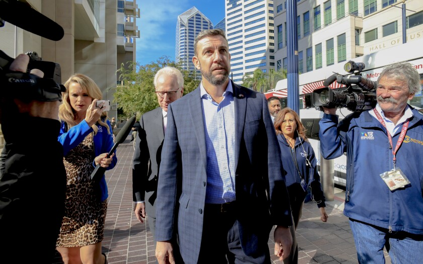Congressman Duncan Hunter arrives just outside of Federal Court with his attorney Paul Pfingst on Nov. 25, 2019.
