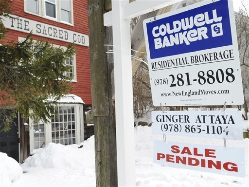 A sale pending sign is seen for a real estate listing, Tuesday, March 3, 2009 in Gloucester, Mass. The number of homebuyers who agreed to purchase an existing home sank to a new low in January as economic woes turned them away from the staggering housing market, the National Association of Realtors said Tuesday. (AP Photo/Lisa Poole)