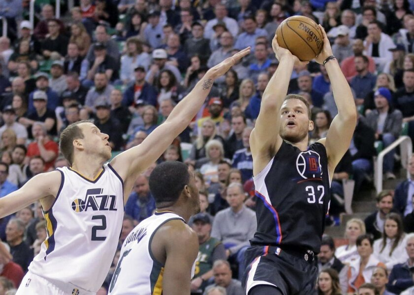 Clippers forward Blake Griffin (32) shoots as Utah Jazz forward Joe Ingles (2) defends in the first half on Feb. 13.