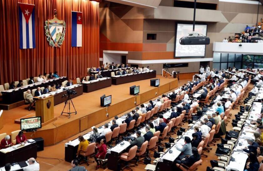 General view of the plenary session of the Second Regular Period of the 9th Legislature of the Cuban Parliament, in Havana, Cuba, 21 December 2018. The reference to communism that had been eliminated in the first draft of the new Cuban Constitution, whose final text votes today the National Assembly (Unicameral Parliament), was again included in the project, after more than 1,800 Cubans they will request. The National Assembly began its first and second plenary session of the year in the first hour of this Friday, in which the new constitutional text will be voted on and will be approved unanimously. EPA-EFE/Ernesto Mastrascusa