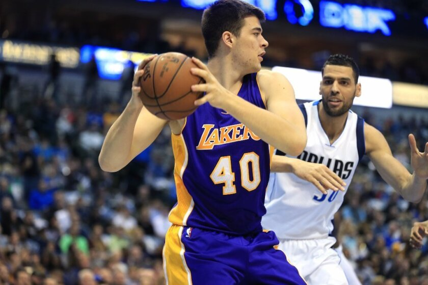 Lakers center Ivica Zubac (40) looks to pass against Dallas Mavericks center Salah Mejri during the first half on Jan. 22.
