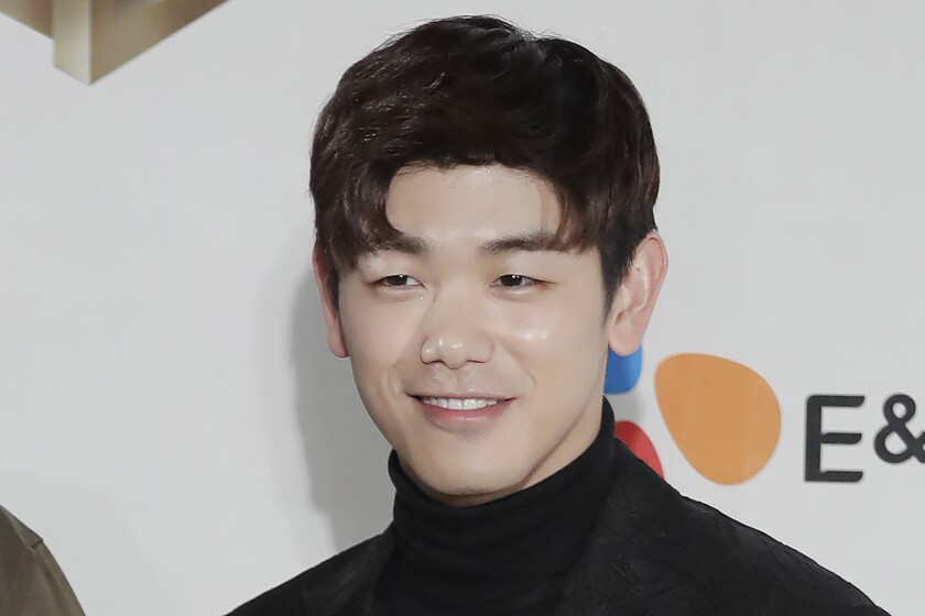 FILE - In this Dec. 2, 2016 file photo, South Korean-American singer-songwriter Eric Nam, poses for the photographers on the red carpet of the 2016 Mnet Asian Music Awards (MAMA) in Hong Kong. Korean American K-pop singers, including Nam, are sharing their experiences with stress in a series of podcasts addressing mental health issues to raise awareness beyond the K-pop community. (AP Photo/Kin Cheung, File)