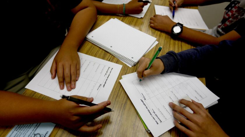 LOS ANGELES, CA - AUGUST 24, 2016: Students work on their class work at Downtown Magnets High School