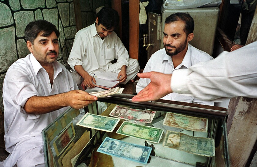 Moneychangers in Peshawar, Pakistan, practice the ancient tradition of hawala, transfering money to other countries on a simple handshake and leaving no paper trail.