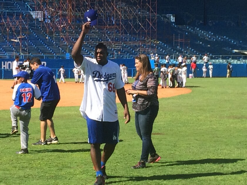 Dodgers outfielder Yasiel Puig tips his cap to the crowd during a MLB goodwill tour.
