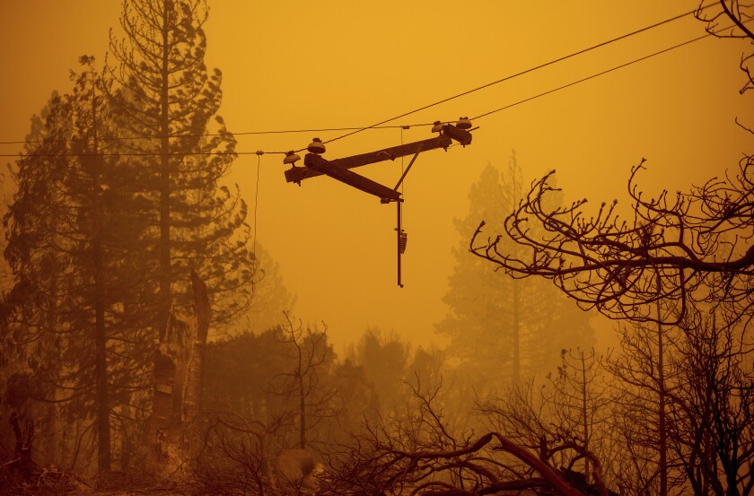 A power line dangles after the Creek Fire on Sept. 8, 2020.