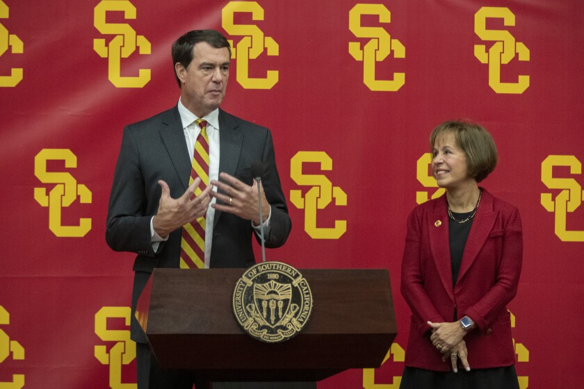 New USC athletic director Mike Bohn speaks, left, USC President Carol L. Folt, right, stands, during news conference on the USC campus on Thursday.