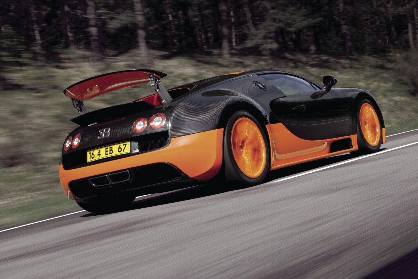 Guinness has reassigned the world record for fastest production car to the Bugatti Veyron Grand Sport. It hit just over 276 mph in a 2010 test.