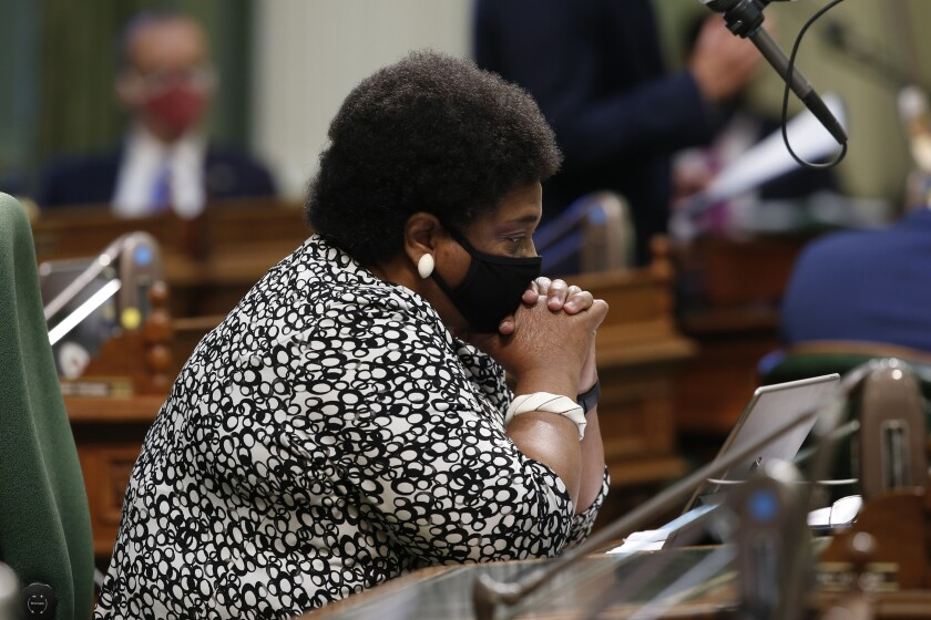 """Assemblywoman Shirley Weber, D-San Diego, rests her head on her hands as she listens to lawmakers discuss her measure to place a constitutional amendment on the ballot to let voters decide if the state should overturn its ban on affirmative action programs, during the Assembly session at the Capitol in Sacramento, Calif., Wednesday, June 10, 2020. California has banned affirmative action-type programs since 1996 when 55% of voters agreed to amend the state's Constitution to ban """"preferential treatment"""" based on race, sex, color, ethnicity or national origin..(AP Photo/Rich Pedroncelli)"""