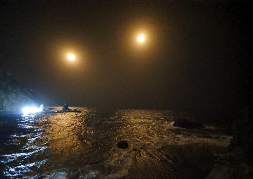 In this photo provided by South Korea Fire Service Headquarters, search and rescue operations are underway in waters following the crash of an ambulance helicopter near the South Korea-controlled islets of Dokdo in waters between the Korean Peninsula and Japan, Friday, Nov. 1, 2019. Rescue workers searched for survivors on Friday after a South Korean ambulance helicopter crashed into waters off the country's eastern coast. (South Korea Fire Service Headquarters via AP)