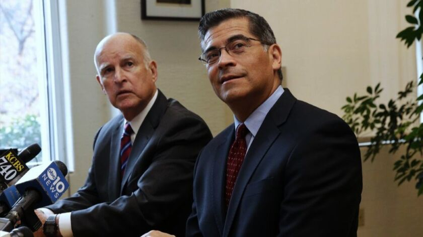 Gov. Jerry Brown, left, and Xavier Becerra, his nominee for California attorney general, answer questions at a news conference in Sacramento on Dec. 5.