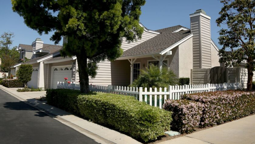 """Authorities arrested Hong """"Gina"""" Jing in this Irvine home and charged her with multiple counts of racketeering and sex trafficking."""