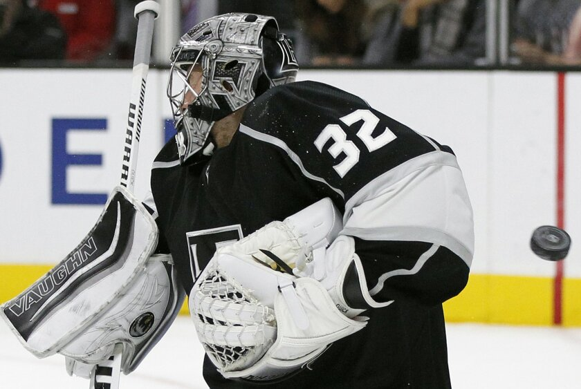Los Angeles Kings goalie Jonathan Quick (32) deflected a shot off his mask by the Florida Panthers during the first period of an NHL hockey game in Los Angeles, Saturday, Nov. 7, 2015. (AP Photo/Alex Gallardo)
