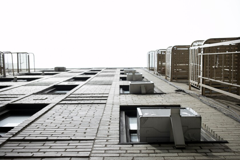 Photo shows window air conditioners in New York.