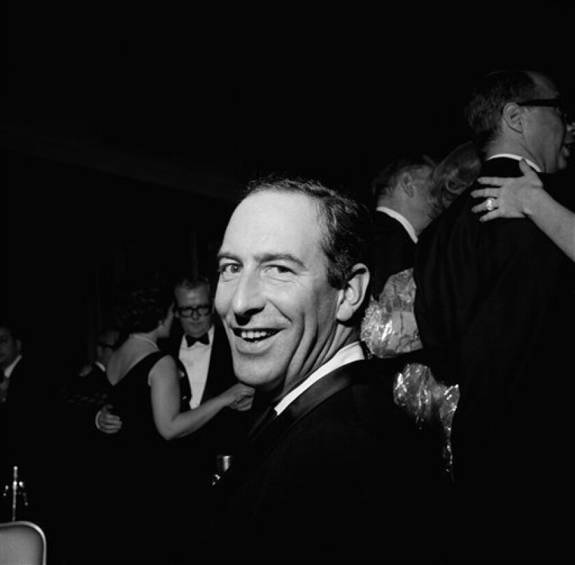 """FILE - In this file photo of Jan. 4, 1967 Thomas P.F. Hoving attends a party in New York shortly after becoming director of the Metropolitan Museum of Art. During his decade as the Met's director he turned an institution he once said was """"dying"""" into a happening with blockbuster exhibits. Hoving died Thursday, Dec. 10, 2009 of cancer at his Manhattan home, according to his family. He was 78. (AP Photo/Marty Lederhandler, File)"""