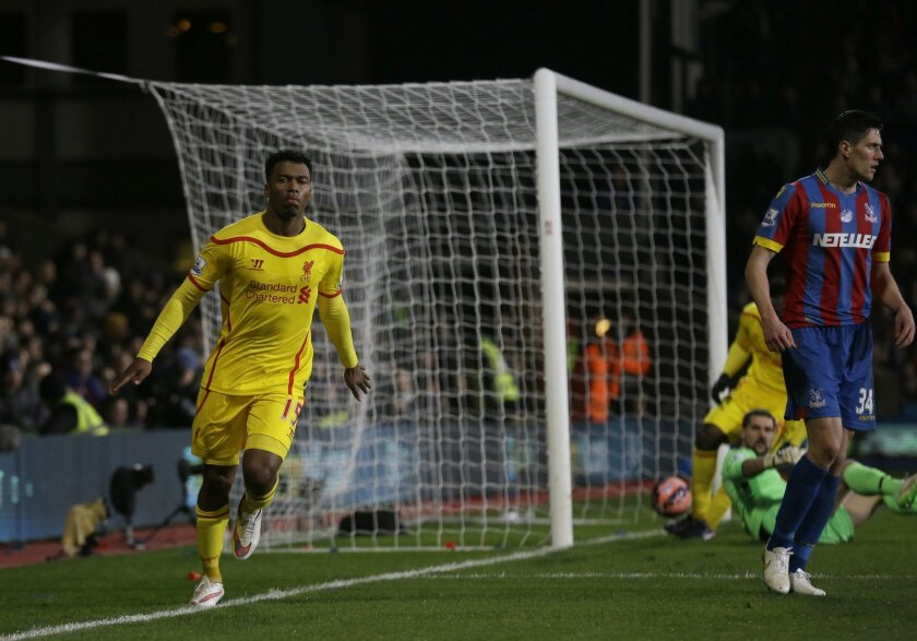 Liverpool's Daniel Sturridge, left, celebrates scoring his side's first goal during the English FA Cup fifth round soccer match between Crystal Palace and Liverpool at Selhurst Park stadium in London, Saturday, Feb. 14, 2015.  (AP Photo/Matt Dunham)