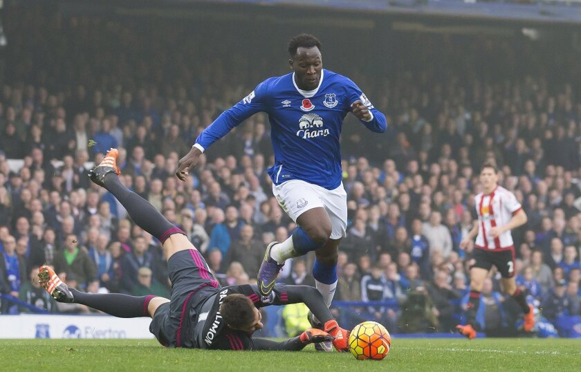 Everton's Romelu Lukaku, top, rounds Sunderland's gaolkeeper Costel Pantilimon to score during the English Premier League soccer match between Everton and Sunderland at Goodison Park Stadium, Liverpool, England, Sunday Nov.1,  2015. (AP Photo/Jon Super)