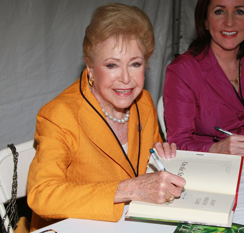 Mary Higgins Clark, signing one of her books, and daughter Carol Higgins Clark at the 2011 L.A. Times Festival of Books.