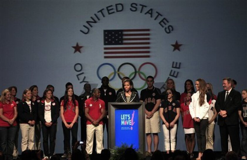 First lady Michelle Obama speaks during a news conference in Dallas, Monday, May 14, 2012, with athletes at the 2012 Team USA Media Summit. The first fady announced a new Let Move initiative to combat childhood obesity.  (AP Photo/LM Otero)