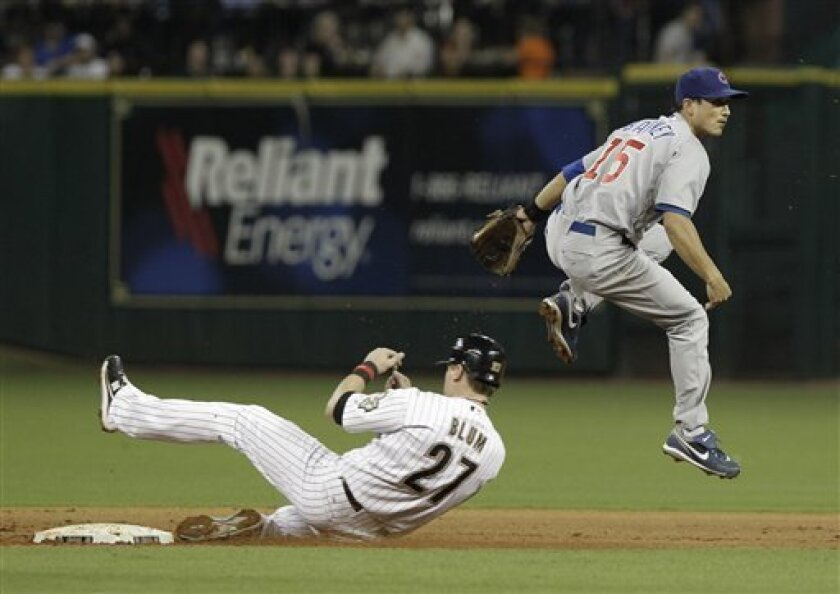 Chicago Cubs shortstop Darwin Barney (15) jumps over Houston Astros' Geoff Blum (27) to watch the completion of a double play on Astros' Jason Michaels at first base in the second inning of a baseball game Friday, Oct. 1, 2010, in Houston. (AP Photo/Pat Sullivan)