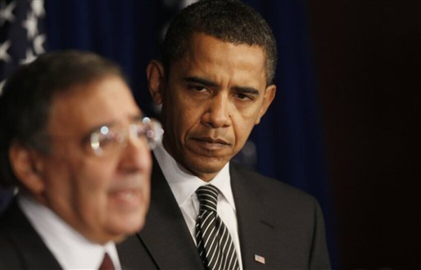 President-elect Barack Obama listens as CIA Director-designate Leon Panetta speaks during a news conference in Washington,  Friday, Jan. 9, 2009. (AP Photo/Charles Dharapak)