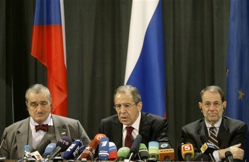 Czech Foreign Minister Karel Schwarzenberg, Russian Foreign Minister Sergey Lavrov and European Union foreign policy chief Javier Solana, from left, are seen during a joint press conference in Moscow on Wednesday, Feb. 11, 2009. Russian and European Union officials are holding talks in Moscow to discuss troubled ties and other international crises. (AP Photo/ Mikhail Metzel)
