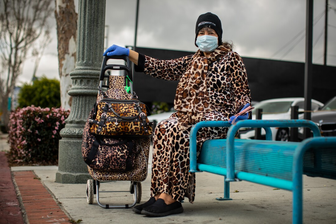A woman named Sarah, who said tigers are her favorite, let out a growl while waiting for a bus on Hawthorne Boulevard in Lawndale.