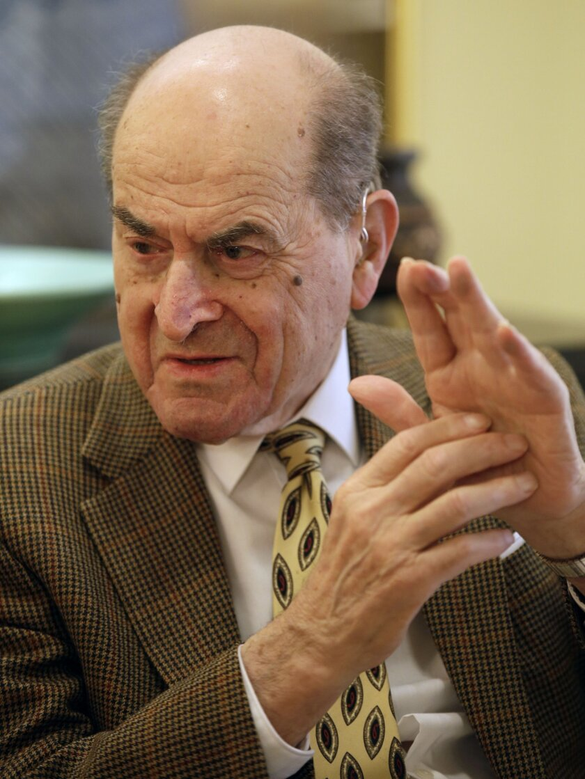 FILE - In this Feb. 5, 2014 file photo, Dr. Henry Heimlich describes the maneuver he developed to help clear obstructions from the windpipes of choking victims, while being interviewed at his home in Cincinnati.  Heimlich  recently used the emergency technique for the first time himself to save a w