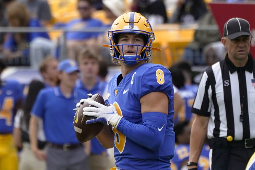 Pittsburgh quarterback Kenny Pickett (8) looks to pass against New Hampshire in the first half of an NCAA college football game, Saturday, Sept. 25, 2021, in Pittsburgh. (AP Photo/Keith Srakocic)