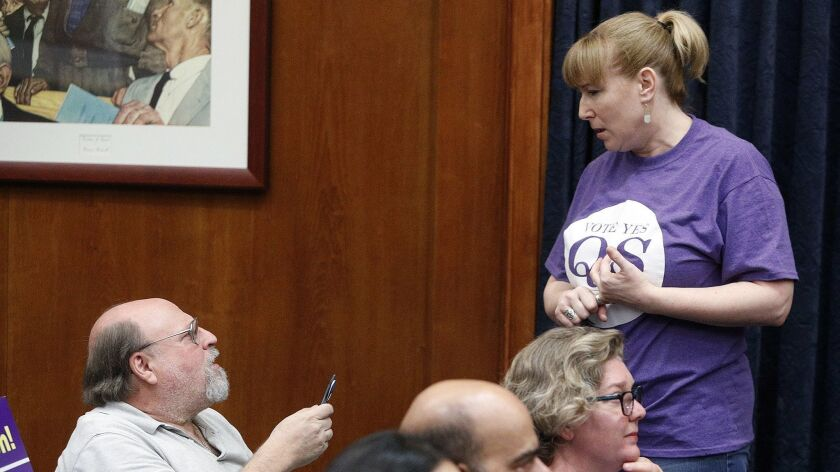 Amy Kamm, of Burbank with the Burbank Council PTA and a supporter of Measure QS, talks with Larry Ap