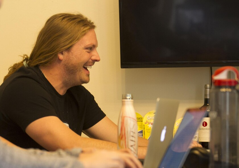 Trevor Jensen laughs during the group's weekly meeting.
